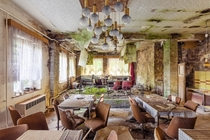 Inside the dining hall of an abandoned hotel  Photographed by Timeless Seeker