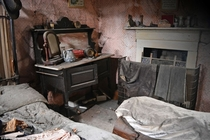 Inside the haunted cottage with a tragic past which has been left to rot with more than  years of valuablesclothes pictures clocks all left untouched Photos by Dan Circa