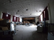 Inside the semi-abandoned gymauditorium of the  school building I attended K- Closed early s