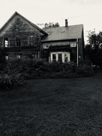 Inspired by another redditor My Great Grandparents dairy farm untouched in a decade since my Gram passed at  If you look close you can still see her knick knacks in the window and front porch lamp lit- Upstate NY