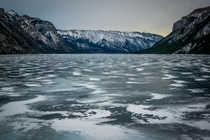 Interesting snow marbling on Lake Minnewanka Alberta Canada