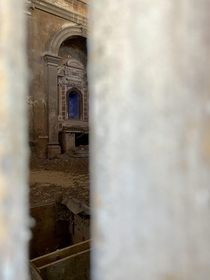Interior of the abandoned church of San Giovanni Battista Correzzo province of Verona region Veneto Italy I could not enter so I took a photo from a crack in a door