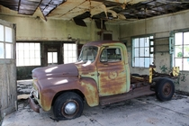 International Harvester pickup found in an abandoned auto repair shop