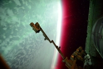 International Space Station captured the planet Earths green auroral display amp rarer reddish band that began during a geomagnetic storm About  km above Earththe orbiting ISS was itself within the realm of the auroral display CreditScott Kelly Expedition
