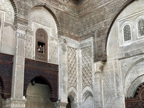 Intricate details at Al-Attarine Madrasa in Fes Morocco