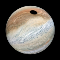 Io Casts a Shadow on Jupiter Image captured by the Juno probe and processed by Kevin Gill a NASA software engineer