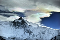 Iridescent ice clouds over the Himalayas by O Bartunova