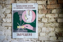 It is forbidden to drill small items without clamping device A Soviet-era hand-painted warning sign in an abandoned harvester depot in the Chernobyl Zone