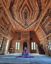 It is totally made of wood This mosque is built according to the earthquake seismicity of Nishapur Iran It is regarded as the first earthquake-proof Wooden Mosque in the world that has an area of  square meters