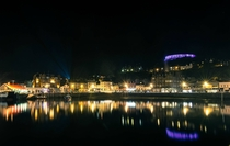 It may be slightly on the bigger side of a village but heres a shot of my hometown Oban Scotland I took last night