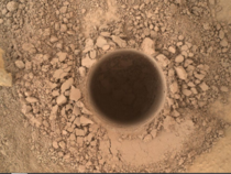 It may look like just a hole in the dirt but this is the first sampling hole made by the Curiosity at Mt Sharp the rovers ultimate science destination