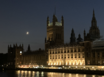 It may only be shot on my iPhone but I do love this picture I stopped to take tonight of the Moon and a very faint Jupiter setting above the Palace of Westminster UK Parliament