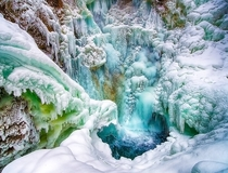 Its hot out there so how about some cold Partially frozen Thunder Bird Falls in Alaska USA