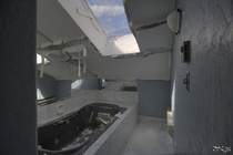 Jacuzzi Tub Under a Skylight in a Decaying Abandoned Mansion