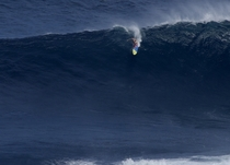 Jeff Rowley rides the Jaws wave Maui HI photo by Shacktown