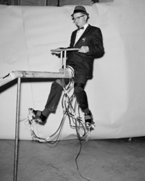 John D Bird with a prototype for jet-propelled shoes at the NASA Langley Research Center in Hampton Virginia