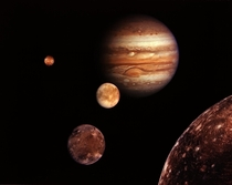 Jupiter amp its four planet-size moons called the Galilean satellites were photographed by Voyager  Reddish Io upper left is nearest Jupiter Europa center Ganymede amp Callisto lower right These are photographed in early March of