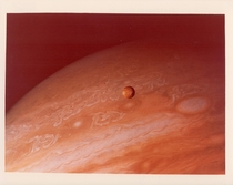 Jupiter and its satellite Io taken by Voyager  June