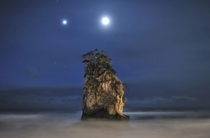 Jupiter and the Moon light up the sky above a rock formation near Kitaibaraki City JapanDr Akira Takaue