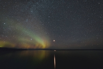 Jupiter reflecting in the lake with a guest appearance by the Northern Lights Saskatchewan