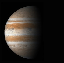 Jupiter with its moon Io visible just at the edge of the planet