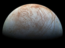 Jupiters moon Europa Visible are plains of bright ice cracks that run to the horizon
