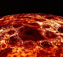 Jupiters North Pole in infrared showing a cluster of  enormous cyclonic storms circling a central region