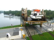 Just a boat crossing a road Big Chute Marine Railway Ontario Canada
