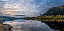 Just a sunrise over a lake next to a random highway in central Norway -shot handheld panorama