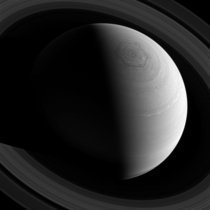 Just as Saturns famous hexagonal shaped jet stream encircles the planets north pole the rings encircle the planet as seen from Cassinis position high above