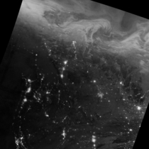 Just hours after the winter solstice a mass of energetic particles from the Sun smashed into the magnetic field around Earth The strong solar wind stream stirred up a display of northern lights over northern Canada