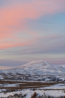 Just lovely pastel colored sky and mountain at dusk Bosnia Livno