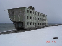Kamchatka Russia Concrete block of flats abandoned in the s There used to be a fishing village