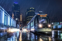 Kansas City Streetcar During Rainstorm by Jonathan Tasler Photography