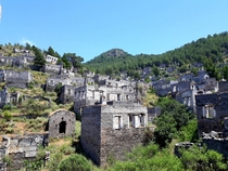 Kayaky the ancient Greek ghost town in Turkey Thousands of identical houses sprawling across the hill side Its been uninhabited since  after the Greco-Turkish war ended in