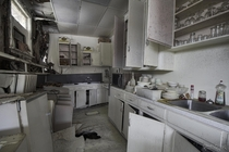 Kitchen Collapsing into itself inside an Abandoned Restaurant with everything left behind