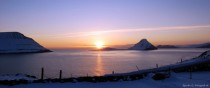 Kitchen view winter sunset Velbastaur Faroe Islands