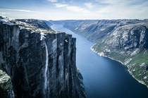 Kjerag or Kiragg is a Norwegian mountain located in Lysefjorden in Forsand municipality Ryfylke Rogaland The drop is  m  ft and it is also the site of Kjeragbolten a  m stone located between two rocks