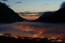 Klaksvk covered by a thin layer of fog at - in the morning Faroe Islands