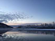 Knik River Alaska reflecting by the water