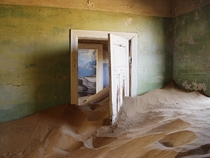 Kolmanskop is a ghost town in Namibia that is slowly being consumed by sand From  to  it was the site of a diamond mine and was home to the first x-ray-station in the southern hemisphere as well as the first tram in Africa  by Damien du Toit