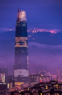 Kuala Lumpur during night with additional features Genting Highland