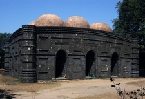 Kusumba mosque at Naogaon Kusumba Mosque termed as the Black Gem of Bengal is situated at the village Kusumba in Naogaon According to an inscription it was erected by a patron Sulayman in - during the reign of Ghiyath al-Din Bahadur Shah Hasan