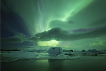 Lagoon Aurora - An amazing aurora-filled sky above Jkulsrln glacial lagoon  photo by Philip Eaglesfield