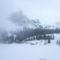 Lake Blanche and Sundial Peak in Utah in the snow and fog