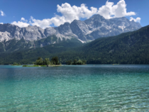 Lake Eibsee with the tallest mountain in Germany Zugspitze in the background Garmisch-Partenkirchen Germany