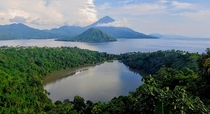 Lake Ngade Ternate in the front of Maitara Island and mount Kie Matubu the highest stratovolcano in North Maluku Indonesia