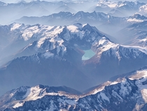 Lake of the Hanging Glacier from my flight passing over the Bugaboos BC Canada Zoom in for bergy bits