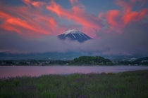 Land of the Rising Sun clouds over Mount Fuji filled with the colors of dawns sunlight  by MIYAMOTO Y x-post rJapanPics