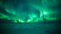 Lapland in Finland lighted up by Aurora Borealis
